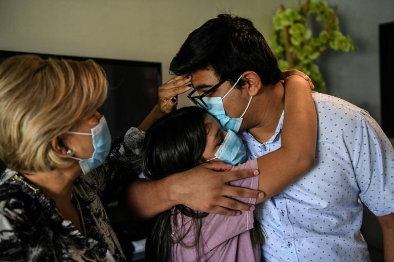 In virus hotspot Florida, a family mourns -- and worries about bills