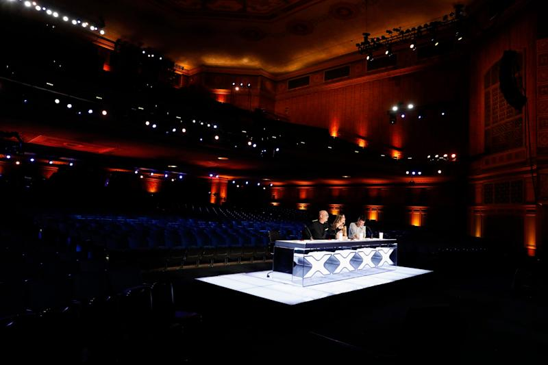 In an 'AGT' first, judges Howie Mandel, left, Sofia Vergara and Simon Cowell observe auditions at the Pasadena Civic Auditorium without the presence of thousands of cheering fans.
