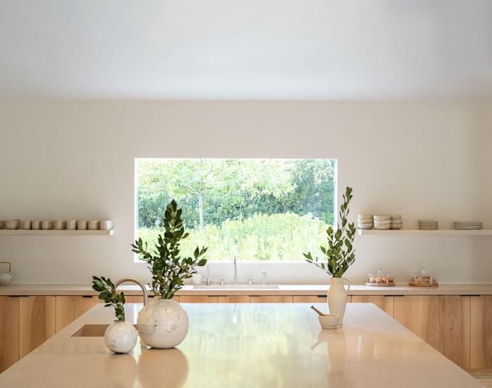 "<div class=""caption""> Shiro Tsujimura ceramic vases top the kitchen island. </div>"