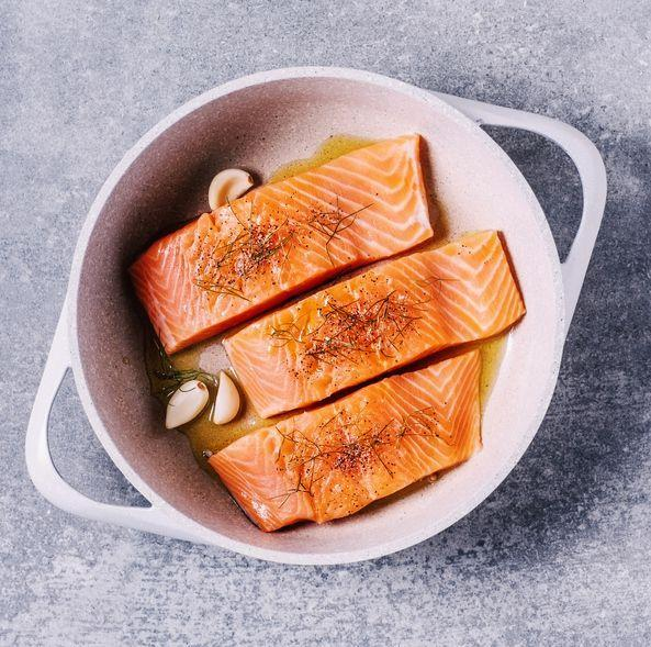 """<p>Fatty fish, like salmon, are rich in omega-3s and a <a href=""""https://www.prevention.com/food-nutrition/healthy-eating/g23065278/high-protein-foods/"""" rel=""""nofollow noopener"""" target=""""_blank"""" data-ylk=""""slk:good source of lean protein"""" class=""""link rapid-noclick-resp"""">good source of lean protein</a>. And while fat has more than double the calories of protein and carbohydrates, it is key to keeping your cravings in check. """"Salmon is not only satisfying and delicious, but it will also make your skin glow, reduce your risk of disease, and even curb your hunger,"""" Mirkin says. </p><p><strong>Try it:</strong> <a href=""""https://www.prevention.com/food-nutrition/recipes/a26986386/salmon-avocado-tomato-salad-recipe/"""" rel=""""nofollow noopener"""" target=""""_blank"""" data-ylk=""""slk:Salmon Salad with Avocado and Sweet Grape Tomatoes"""" class=""""link rapid-noclick-resp"""">Salmon Salad with Avocado and Sweet Grape Tomatoes</a></p>"""