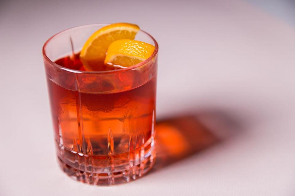 """<p>The Negroni is one of the world's great cocktails, and we tapped <a href=""""https://www.santambroeus.com/"""" rel=""""nofollow noopener"""" target=""""_blank"""" data-ylk=""""slk:Sant Ambroeus"""" class=""""link rapid-noclick-resp"""">Sant Ambroeus</a>, one of our favorite Italian destinations when in New York, Southampton, or Palm Beach for directions on how to make a perfect one. </p><p><strong>Ingredients:</strong></p><p>1 ounce Campari </p><p>1 ounce gin </p><p>1 ounce semi-sweet red vermouth </p><p>Orange peel, for garnish</p><p><strong>Directions:</strong></p><p>In a shaker add all the ingredients, stir with bar spoon in rocks glass and strain the liquid with a strainer. garnish with orange peel. </p>"""