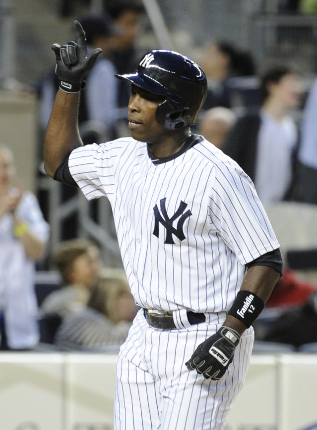 New York Yankees' Alfonso Soriano reacts as he comes home after hitting a home run during the second inning of a baseball game against the Boston Red Sox Friday, April 11, 2014, at Yankee Stadium in New York. (AP Photo/Bill Kostroun)