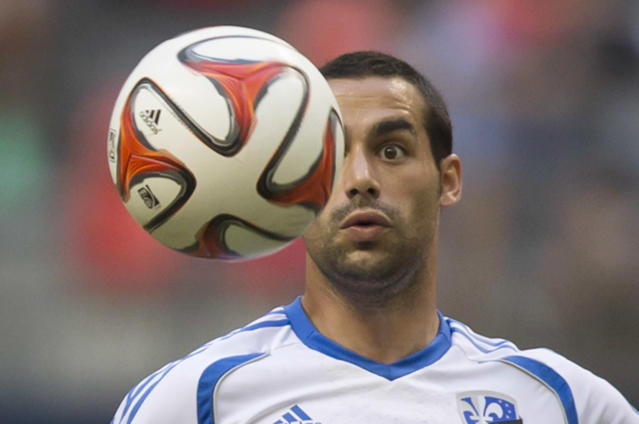 Montreal Impact's Andres Romero follows the ball during the first half of an MLS soccer game against the Vancouver Whitecaps on Wednesday, June 25, 2014, in Vancouver, British Columbia. (AP Photo/The Canadian Press, Darryl Dyck)