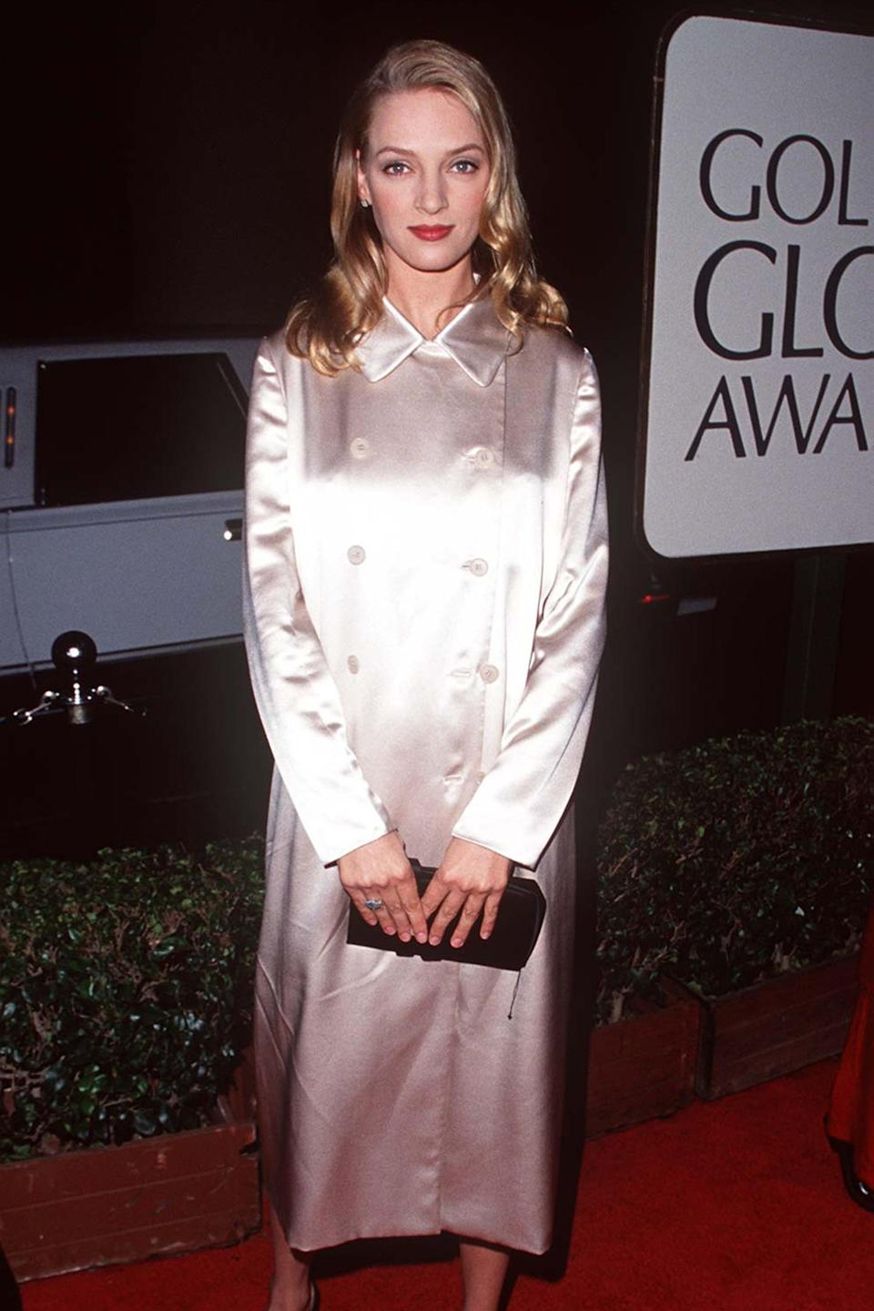 """<strong><h2>1995</h2></strong><br>We're always keen on a red carpet look that goes against the grain, so naturally, Uma Thurman showing up to the Golden Globes in this classic satin coat instead of a dress has us bowing our hats.<br><br><em>Uma Thurman in a white coat. </em><span class=""""copyright"""">Photo: Steve Granitz/WireImage.</span>"""