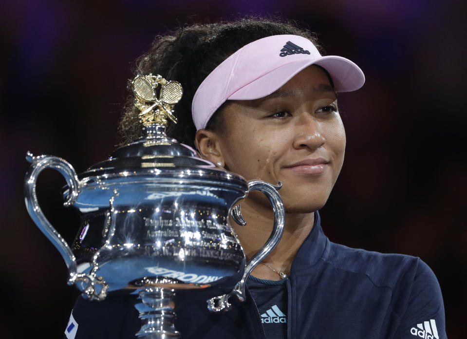 Japan's Naomi Osaka holds her trophy after defeating Petra Kvitova of the Czech Republic during the women's singles final at the Australian Open tennis championships in Melbourne, Australia, Saturday, Jan. 26, 2019. (AP Photo/Mark Schiefelbein)