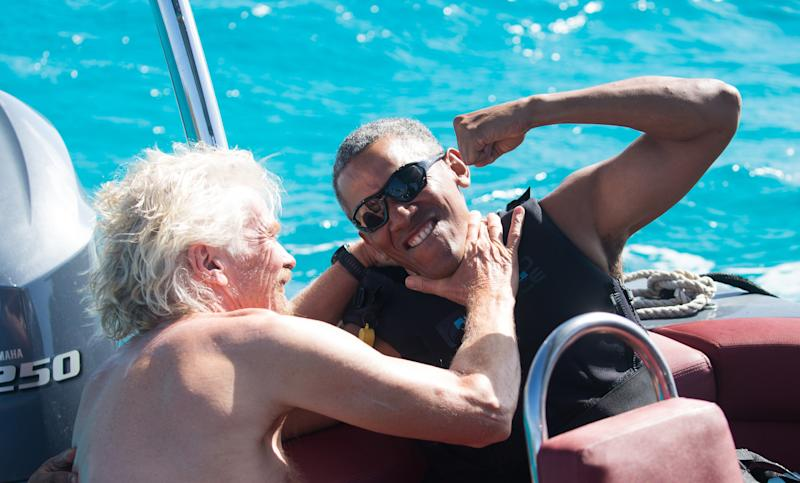 Former U.S. President Barack Obama and Richard Branson sit on a boat during Obama's holiday on Branson's Moskito island on Feb. 7, 2017.  (Handout . / Reuters)
