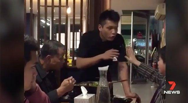 A fellow diner recorded an argument between Chungping Quan and a waiter. Source: 7 News