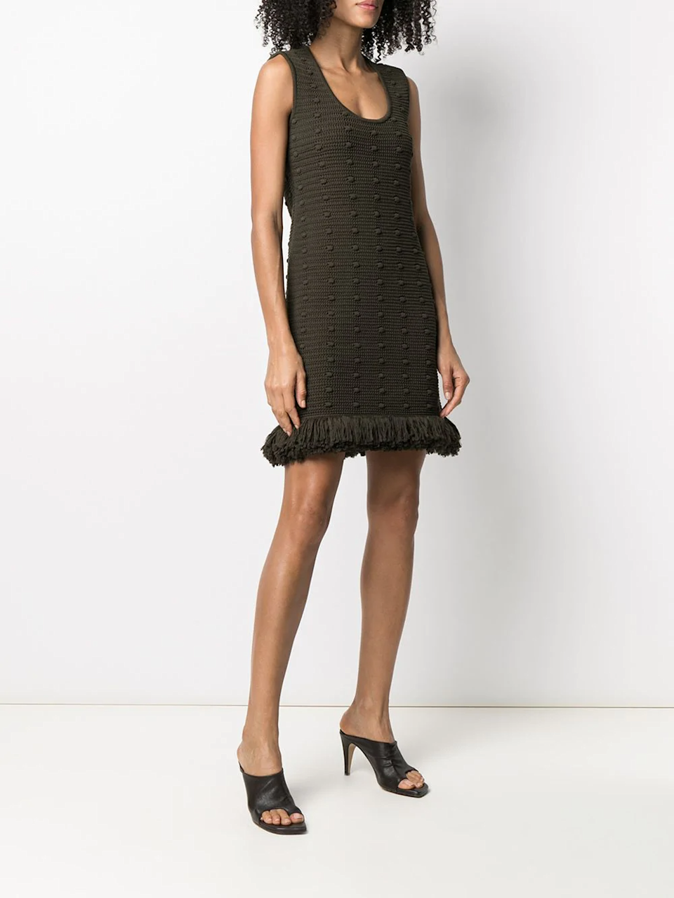"""<h2>The Knit Dress</h2><br>""""After a year of stocking up on loungewear, many people are keen to move beyond sweats and to start enjoying the experience of getting dressed again. With so much time still being spent at home, the knit dress is the ideal transitional piece, maintaining maximum comfort.""""<br><br>-Celenie Seidel, Senior Womenswear Editor at FARFETCH<br><br><strong>Bottega Veneta</strong> Knitted Fringe-Trim Dress, $, available at <a href=""""https://go.skimresources.com/?id=30283X879131&url=https%3A%2F%2Fwww.farfetch.com%2Fshopping%2Fwomen%2Fbottega-veneta-knitted-fringe-trim-dress-item-16143730.aspx%3Fstoreid%3D9671"""" rel=""""nofollow noopener"""" target=""""_blank"""" data-ylk=""""slk:Farfetch"""" class=""""link rapid-noclick-resp"""">Farfetch</a>"""
