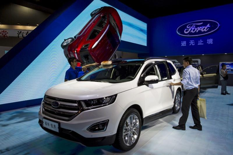 FILE PHOTO: A visitor gets in a Ford Edge SUV at the 13th China (Guangzhou) International Automobile Exhibition in Guangzhou