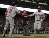 Washington Nationals' Adam Eaton, right, is congratulated by Brian Dozier (9) after scoring against the San Francisco Giants in the fifth inning of a baseball game Monday, Aug. 5, 2019, in San Francisco. (AP Photo/Ben Margot)