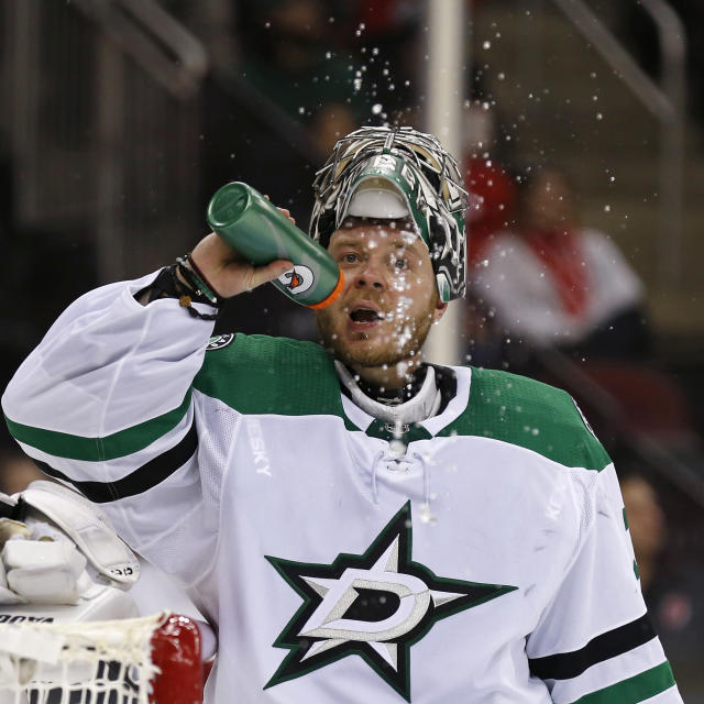 Dallas Stars goaltender Anton Khudobin reacts after giving up a goal to New Jersey Devils' Jean-Sebastien Dea in the second period of an NHL hockey game, Tuesday, Oct. 16, 2018, in Newark, N.J. (AP Photo/Adam Hunger)
