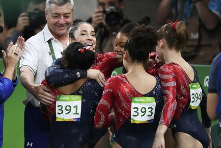 2016 Rio Olympics - Artistic Gymnastics - Preliminary - Women's Qualification - Subdivisions - Rio Olympic Arena - Rio de Janeiro, Brazil - 07/08/2016. Alexandra Raisman (USA) of USA (Aly Raisman), Gabrielle Douglas (USA) of USA (Gabby Douglas), Simone Biles (USA) of USA (391), Laurie Hernandez (USA) of USA (393) and Madison Kocian (USA) of USA during the women's qualifications. REUTERS/Dylan Martinez
