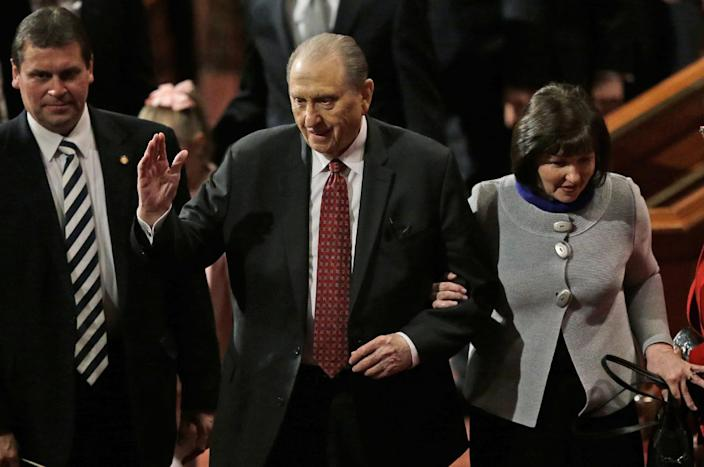 Thomas S. Monson, president of the Church of Jesus Christ of Latter-day Saints, walks with his daughter, Ann M. Dibb, right, following the morning session Saturday, April 5, 2014, in Salt Lake City. More than 100,000 Latter-day Saints are expected in Salt Lake City this weekend for the church's biannual general conference. Leaders of The Church of Jesus Christ of Latter-day Saints give carefully crafted speeches aimed at providing members with guidance and inspiration in five sessions that span Saturday and Sunday. They also make announcements about church statistics, new temples or initiatives. In addition to those filling up the 21,000-seat conference center during the sessions, thousands more listen or watch around the world in 95 languages on television, radio, satellite and Internet broadcasts. (AP Photo/Rick Bowmer)