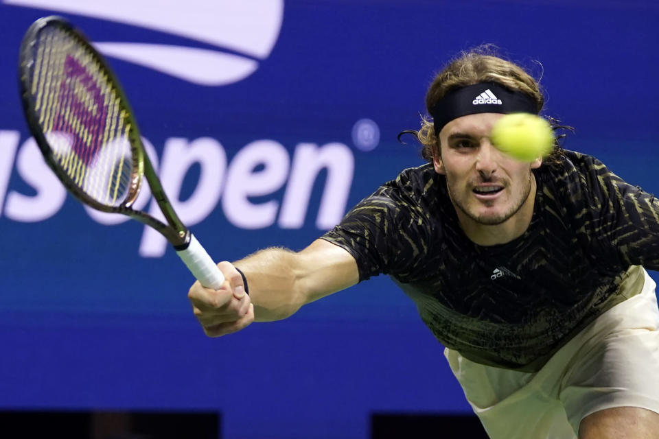 Stefanos Tsitsipas, of Greece, returns a shot against Adrian Mannarino, of France, during the second round of the US Open tennis championships, Wednesday, Sept. 1, 2021, in New York. (AP Photo/Frank Franklin II)