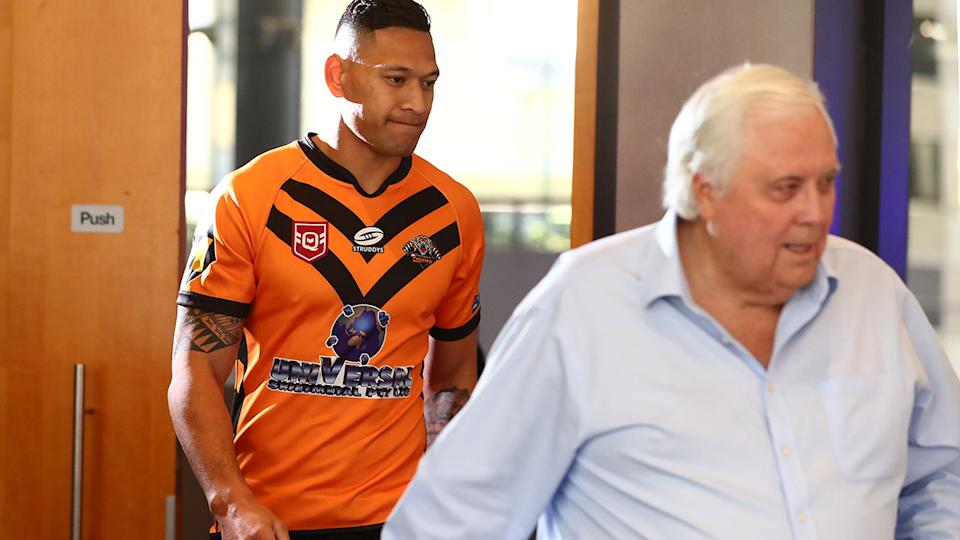 Israel Folau, pictured here arriving at his press conference with Clive Palmer.
