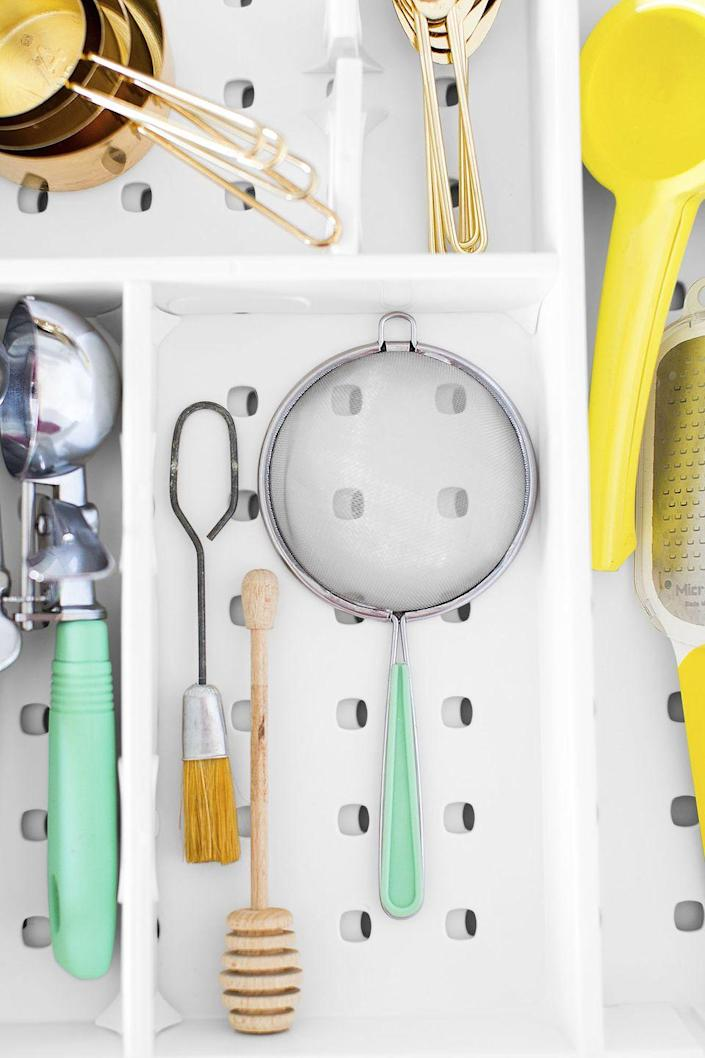 """<p>Detangle kitchen tools with drawer dividers. Adjustable dividers like this <a href=""""https://www.amazon.com/OXO-Grips-Expandable-Utensil-Organizer/dp/B016AIEQFU?th=1&tag=syn-yahoo-20&ascsubtag=%5Bartid%7C10060.g.36311015%5Bsrc%7Cyahoo-us"""" rel=""""nofollow noopener"""" target=""""_blank"""" data-ylk=""""slk:expandable utensil organizer from OXO"""" class=""""link rapid-noclick-resp"""">expandable utensil organizer from OXO</a> accommodate big, small, and awkwardly shaped tools. Finally, you'll be able to find your<a href=""""https://www.goodhousekeeping.com/search/?q=ice+cream"""" rel=""""nofollow noopener"""" target=""""_blank"""" data-ylk=""""slk:ice cream scoop"""" class=""""link rapid-noclick-resp""""> ice cream scoop</a> in peace!</p><p><a class=""""link rapid-noclick-resp"""" href=""""https://www.amazon.com/OXO-Grips-Expandable-Utensil-Organizer/dp/B016AIEQFU?th=1&tag=syn-yahoo-20&ascsubtag=%5Bartid%7C10060.g.36311015%5Bsrc%7Cyahoo-us"""" rel=""""nofollow noopener"""" target=""""_blank"""" data-ylk=""""slk:SHOP EXPANDABLE ORGANIZERS"""">SHOP EXPANDABLE ORGANIZERS</a></p>"""