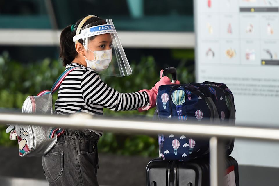 A child waits in a line outside the Indira Gandhi International airport during the first day of resuming of domestic flights after the government imposed a nationwide lockdown as a preventive measure against the spread of the COVID-19 coronavirus in New Delhi on May 25, 2020. (Photo by Money SHARMA / AFP) (Photo by MONEY SHARMA/AFP via Getty Images)