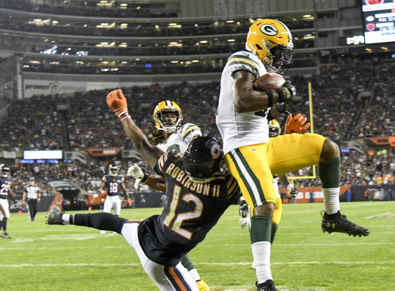 Green Bay Packers' Adrian Amos intercepts a pass during the second half of an NFL football game against the Chicago Bears Thursday, Sept. 5, 2019, in Chicago. The Packers won 10-3. (AP Photo/David Banks)
