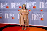 Billie Eilish is up for international female solo artist of the year. She's rocking head-to-toe Burberry and her signature too-long-to-text nails. (Getty Images)