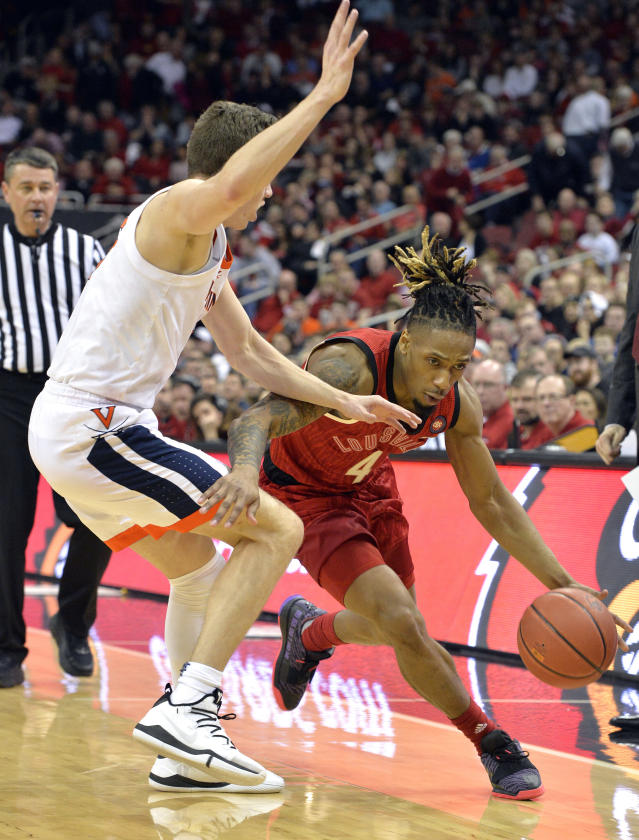 Louisville guard Khwan Fore (4) attempts to drive under the defense of Virginia guard Kyle Guy (5) during the second half of an NCAA college basketball game in Louisville, Ky., Saturday, Feb. 23, 2019. Virginia won 64-52. (AP Photo/Timothy D. Easley)