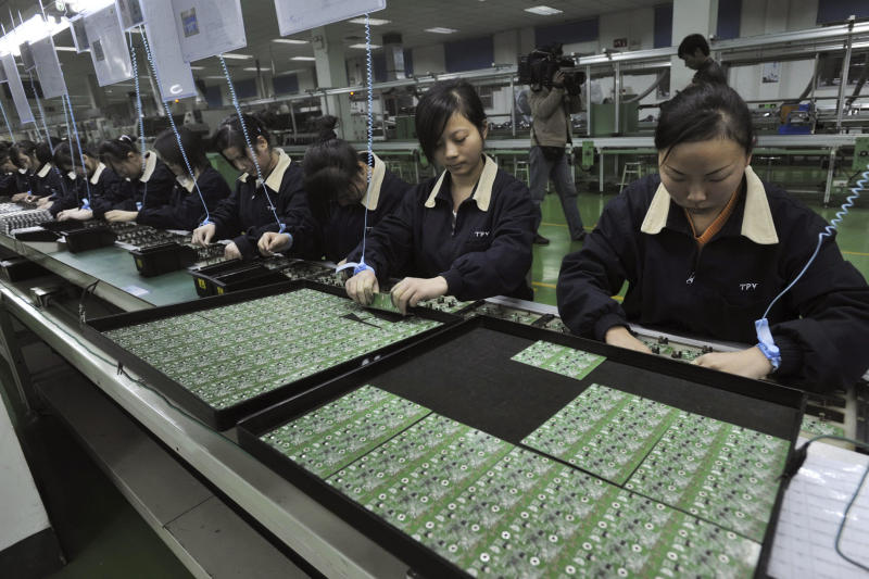 In this Nov. 22, 2008 photo, women work on an assembly line at a factory of Proview Technology in Wuhan, in central China's Hubei province. The battle between the ailing Chinese electronics maker and Apple Inc. over the iPad name is just as much a tale of obsolescence in the fast-moving global technology industry as it is a legal row over a trademark. (AP Photo)  CHINA OUT