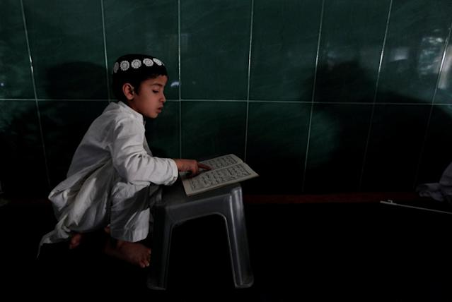 <p>A boy learns to read the Quran at a mosque during the holy month of Ramadan, in Islamabad, Pakistan, May 29, 2017. (Faisal Mahmood/Reuters) </p>