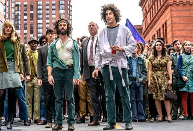 Jeremy Strong and Sacha Baron Cohen from a scene in Netflix's The Trial of the Chicago 7.