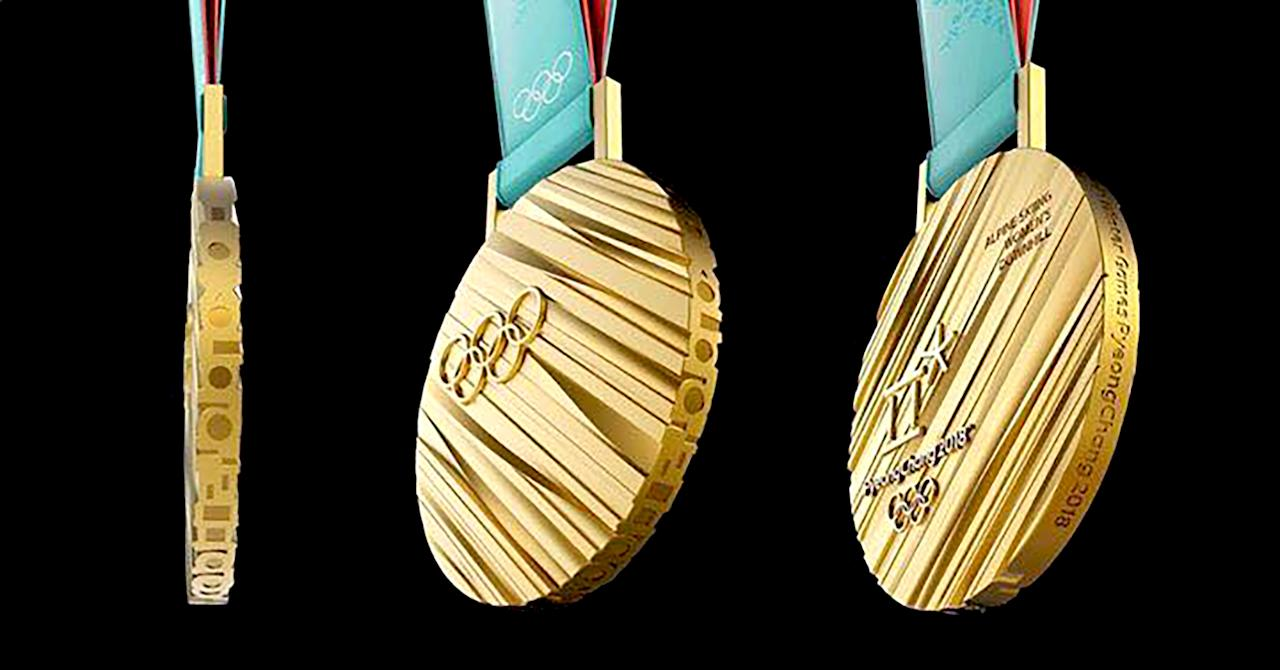 """<p>The medals for the 2018 Winter Olympics were inspired by Hangeul, the Korean alphabet. Viewed from the side, Korean consonants spell '<a rel=""""nofollow"""" href=""""https://www.pyeongchang2018.com/en/medal"""">Olympic Winter Games PyeongChang 2018</a>.' The gold medal weighs 586 grams (1.29 pounds)–believed to be the <a rel=""""nofollow"""" href=""""https://ec.yimg.com/ec?url=http%3a%2f%2folympics.nbcsports.com%2f2017%2f09%2f20%2fpyeongchang-olympic-medals-unveiled%2f%26quot%3b%26gt%3bheaviest%26lt%3b%2fa%26gt%3b&t=1524318867&sig=dN.FFuc94d6wKVwXc7zvMg--~D in Olympic history.<br /> (Photo via Facebook/swna) </p>"""