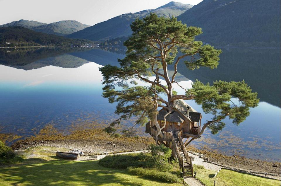 """<p>Here's an excellent excuse to hop across the pond. This dreamy Scottish cottage overlooks an incredibly scenic loch and has hosted hundreds of weddings (it's easy to see why!).</p><p><a class=""""link rapid-noclick-resp"""" href=""""https://go.redirectingat.com?id=74968X1596630&url=https%3A%2F%2Fwww.tripadvisor.com%2FHotel_Review-g315997-d305519-Reviews-The_Lodge_on_Loch_Goil-Loch_Goil_Argyll_and_Bute_Scotland.html&sref=https%3A%2F%2Fwww.housebeautiful.com%2Fdesign-inspiration%2Fhouse-tours%2Fg3301%2Famazing-tree-house-homes%2F"""" rel=""""nofollow noopener"""" target=""""_blank"""" data-ylk=""""slk:BOOK NOW"""">BOOK NOW</a> <strong><em>Treehouse on Loch Goil</em></strong></p>"""