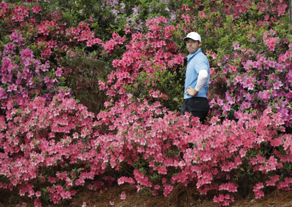 FILE - Rory McIlroy, of Northern Ireland, hits from the azaleas on the 13th hole during the third round at the Masters golf tournament in Augusta, Ga., in this Saturday, April 7, 2018, file photo. Along with the spring colors, the volume returns, though not to the same decibel. Augusta National had no choice but to keep the spectators away in November because of the pandemic, just like the other majors last year. (AP Photo/David J. Phillip, File)