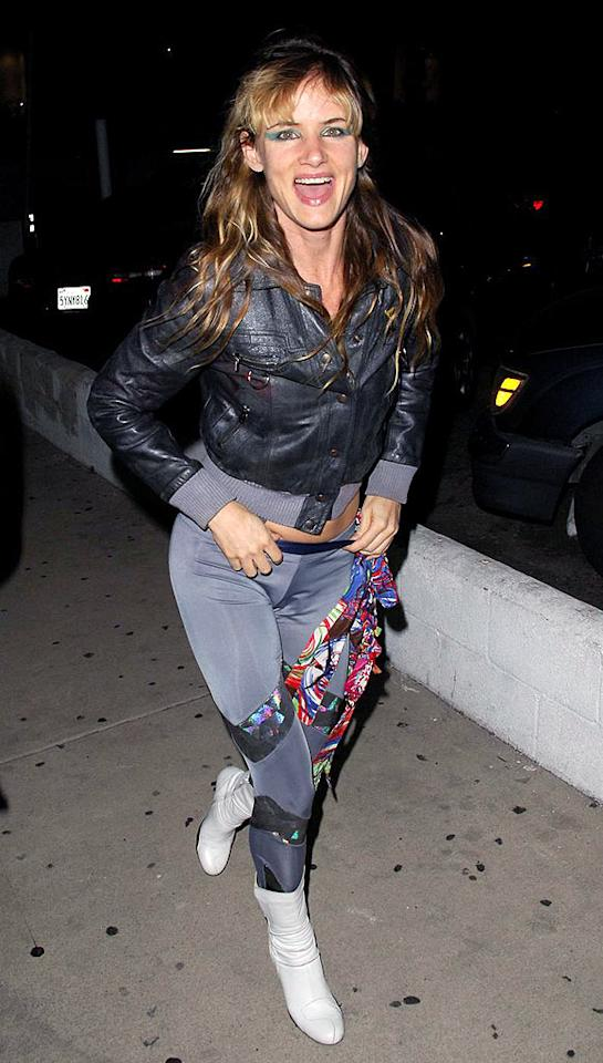 "Juliette Lewis' velvet jumpsuit, shocking eye shadow, and unattractive boots are all unforgivable! Adrian Varnedoe/<a href=""http://www.pacificcoastnews.com/"" target=""new"">PacificCoastNews.com</a> - June 27, 2008"