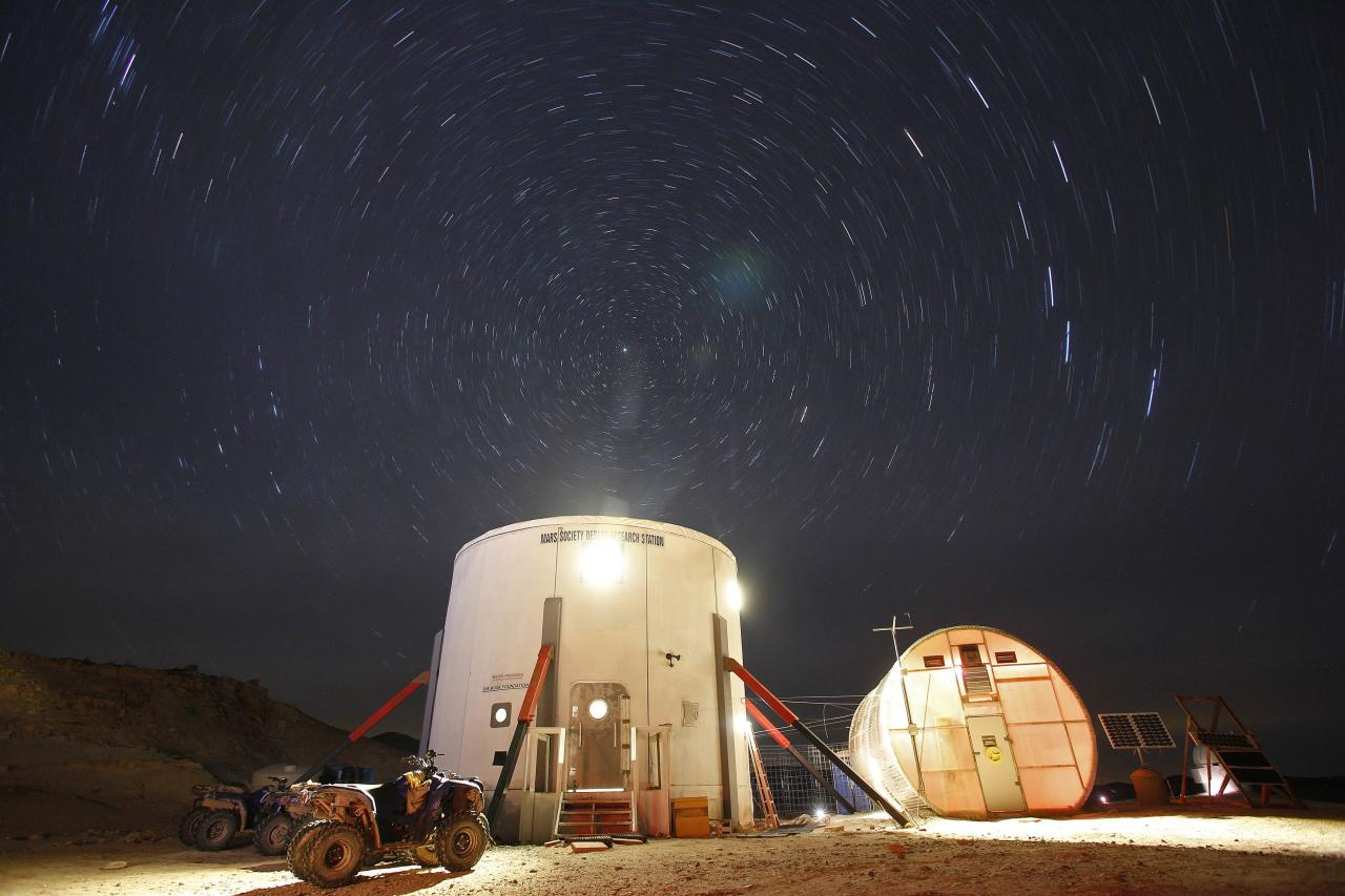 """A view of the night sky above the Mars Desert Research Station (MDRS) is seen outside Hanksville in the Utah desert March 2, 2013. The MDRS aims to investigate the possibility of a human exploration of Mars and takes advantage of the Utah desert's Mars-like terrain to simulate working conditions on the red planet. Scientists, students and enthusiasts work together to develop field tactics and study the terrain while wearing simulated spacesuits and carrying air supply packs. They live together in a small communication base with limited space and supplies. Picture taken March 2, 2013. REUTERS/Jim Urquhart"