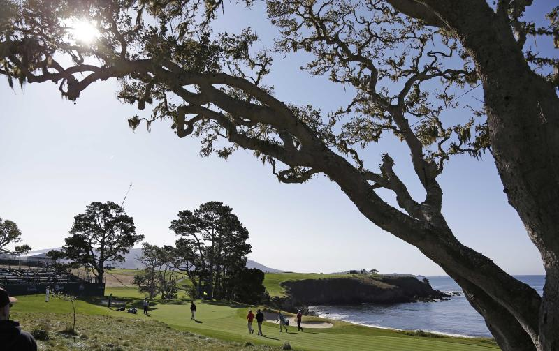 Padraig Harrington of Ireland, and his playing group make their way to the fifth green of the Pebble Beach Golf Links during a practice round of the AT&T Pebble Beach Pro-Am golf tournament Wednesday, Feb. 6, 2013 in Pebble Beach, Calif. (AP Photo/Eric Risberg)