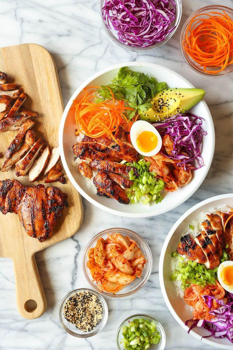 """<p>This marinade includes grated pear, fresh cilantro, gochujang, and toasted sesame oil to give chicken a juicy, flavorful boost. Try it in grilled chicken bowls topped with caramelized kimchi. </p><p><strong>Get the recipe at <a href=""""https://damndelicious.net/2020/03/09/korean-chicken-bowls/"""" rel=""""nofollow noopener"""" target=""""_blank"""" data-ylk=""""slk:Damn Delicious"""" class=""""link rapid-noclick-resp"""">Damn Delicious</a>.</strong></p><p><a class=""""link rapid-noclick-resp"""" href=""""https://go.redirectingat.com?id=74968X1596630&url=https%3A%2F%2Fwww.walmart.com%2Fbrowse%2Fhome%2Fmixing-bowls%2F4044_623679_133020_4496646_2514018&sref=https%3A%2F%2Fwww.thepioneerwoman.com%2Ffood-cooking%2Frecipes%2Fg36491151%2Fmarinade-recipes-for-grilling%2F"""" rel=""""nofollow noopener"""" target=""""_blank"""" data-ylk=""""slk:SHOP MIXING BOWLS"""">SHOP MIXING BOWLS</a></p>"""