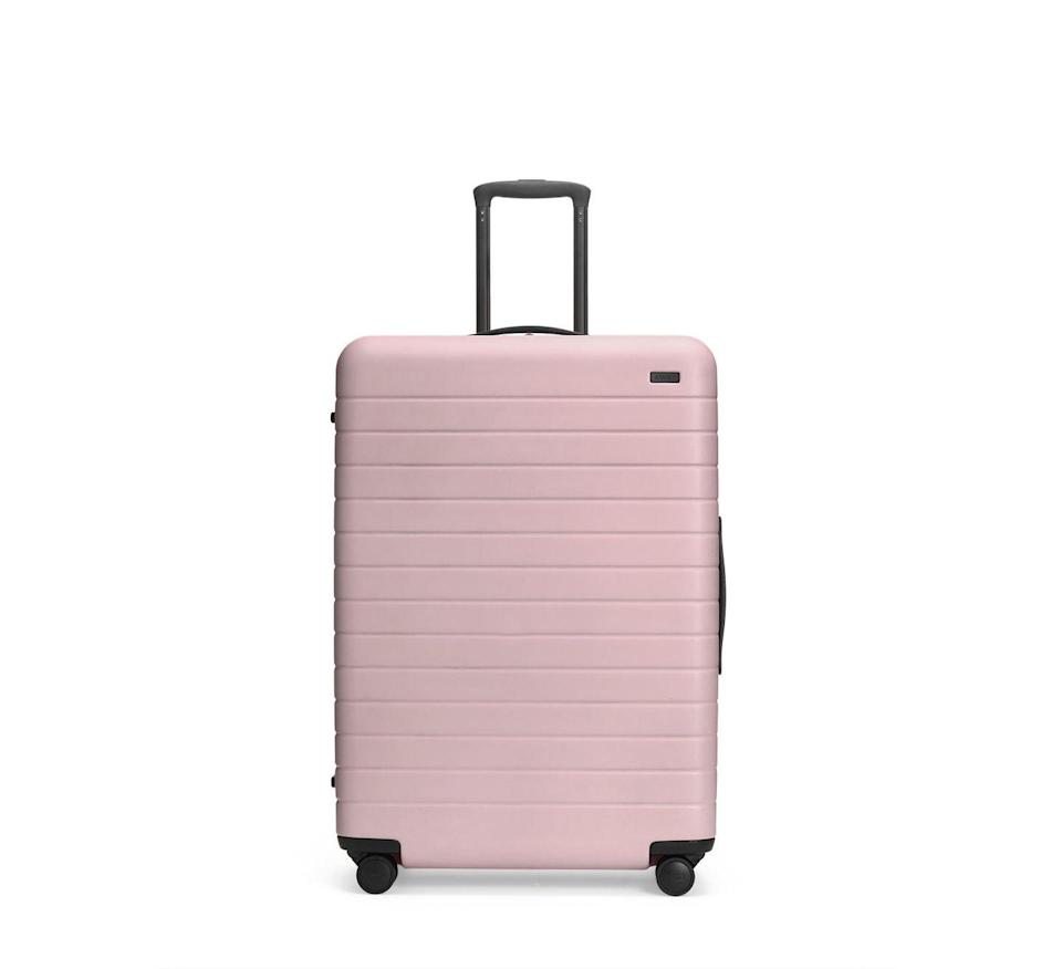 """<p><a class=""""link rapid-noclick-resp"""" href=""""https://go.redirectingat.com?id=127X1599956&url=https%3A%2F%2Fwww.awaytravel.com%2Fuk%2Fen%2Fsuitcases%2Flarge%2Fblush&sref=https%3A%2F%2Fwww.cosmopolitan.com%2Fuk%2Fentertainment%2Ftravel%2Fg28101108%2Flarge-suitcase%2F"""" rel=""""nofollow noopener"""" target=""""_blank"""" data-ylk=""""slk:BUY NOW"""">BUY NOW</a> <strong>£295</strong></p><p>Away's cutting-edge suitcase in The Large offers one of the most stylish ways to travel. Loved by celebs from Meghan Markle to Margot Robbie, the luggage comes with 360-degree spinner wheels, leather details and a hidden laundry bag.</p>"""