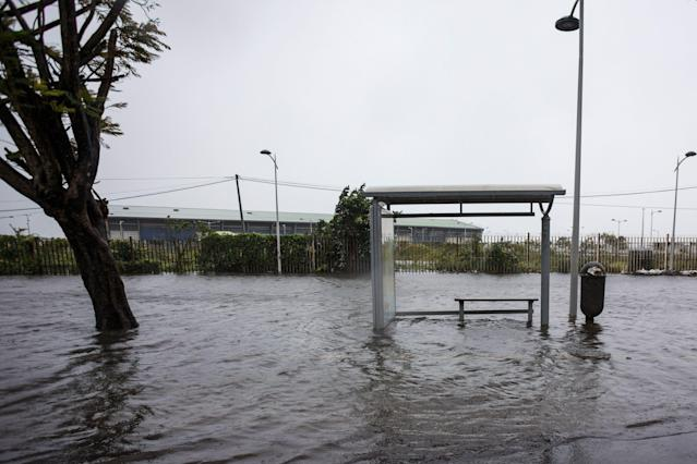 <p>A flooded road and a bus stop are pictured on Boulevard Chanzy in downtown Pointe-a-Pitre on Sept. 19, 2017 in the French territory of Guadeloupe after the passage of Hurricane Maria. (Photo: Cedrick Isham Calvados/AFP/Getty Images) </p>