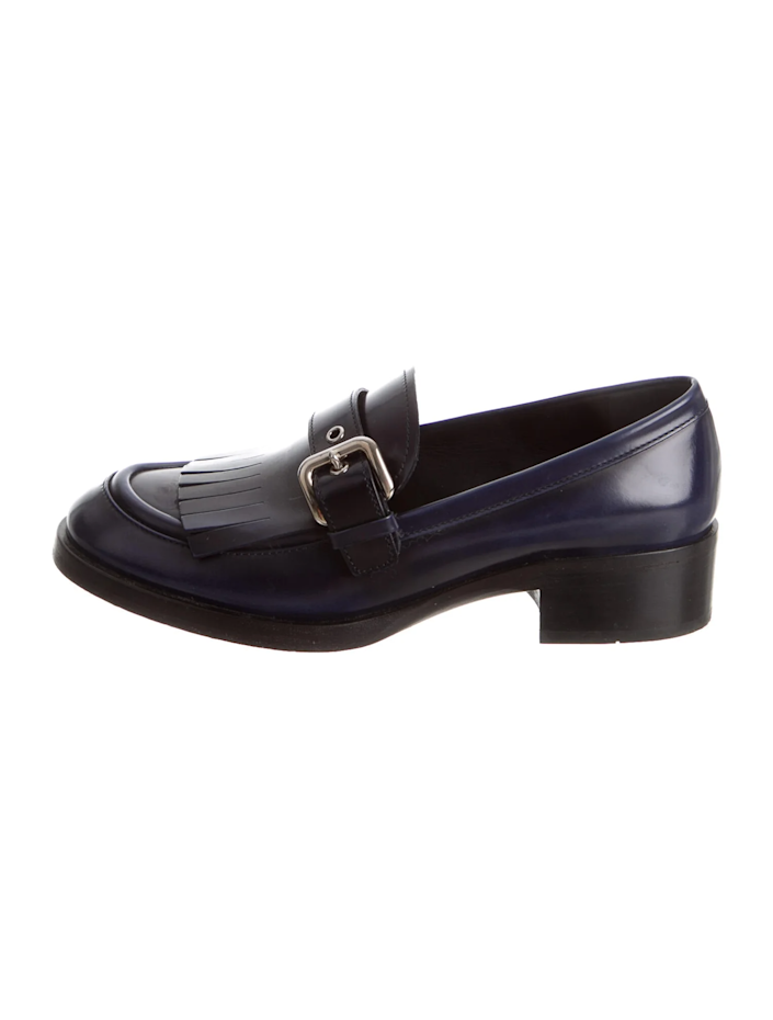 "<br> <br> <strong>Prada</strong> Leather Fringe Trim Accent Loafers, $, available at <a href=""https://go.skimresources.com/?id=30283X879131&url=https%3A%2F%2Fwww.therealreal.com%2Fproducts%2Fwomen%2Fshoes%2Fflats%2Fprada-leather-fringe-trim-accent-loafers-86j2h%3Fposition%3D44"" rel=""nofollow noopener"" target=""_blank"" data-ylk=""slk:The RealReal"" class=""link rapid-noclick-resp"">The RealReal</a>"