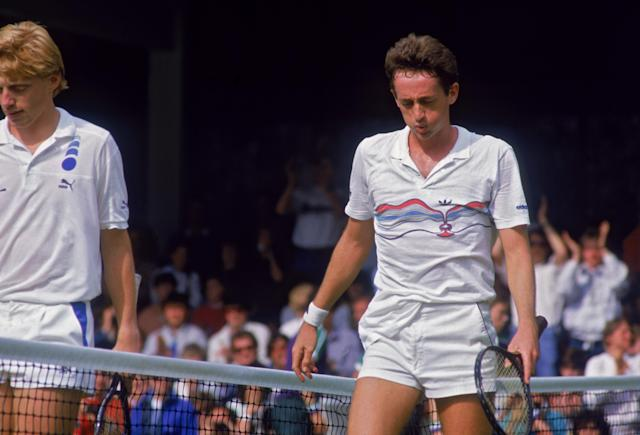 Defending champion Boris Becker of West Germany (left) and unseeded Australian tennis player Peter Doohan during their second-round match in the Championships at Wimbledon, London, 26th June 1987. Doohan eventually defeated the top-seeded player, 7-6, 4-6, 6-2, 6-4. (Photo by Chris Cole/Getty Images)