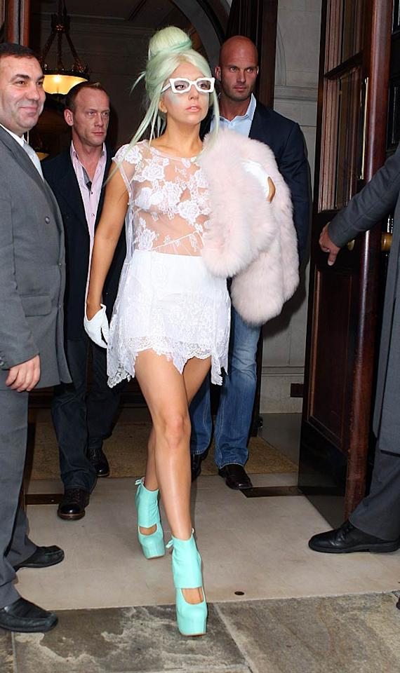 I'll admit that Lady Gaga's aqua-colored, platform boots are secretly fierce, but her sea foam green-tinted tresses -- which are woven into a sloppy beehive -- and matching blush are both far from fashionable.  Gotcha Images/Splash News - October 5, 2011