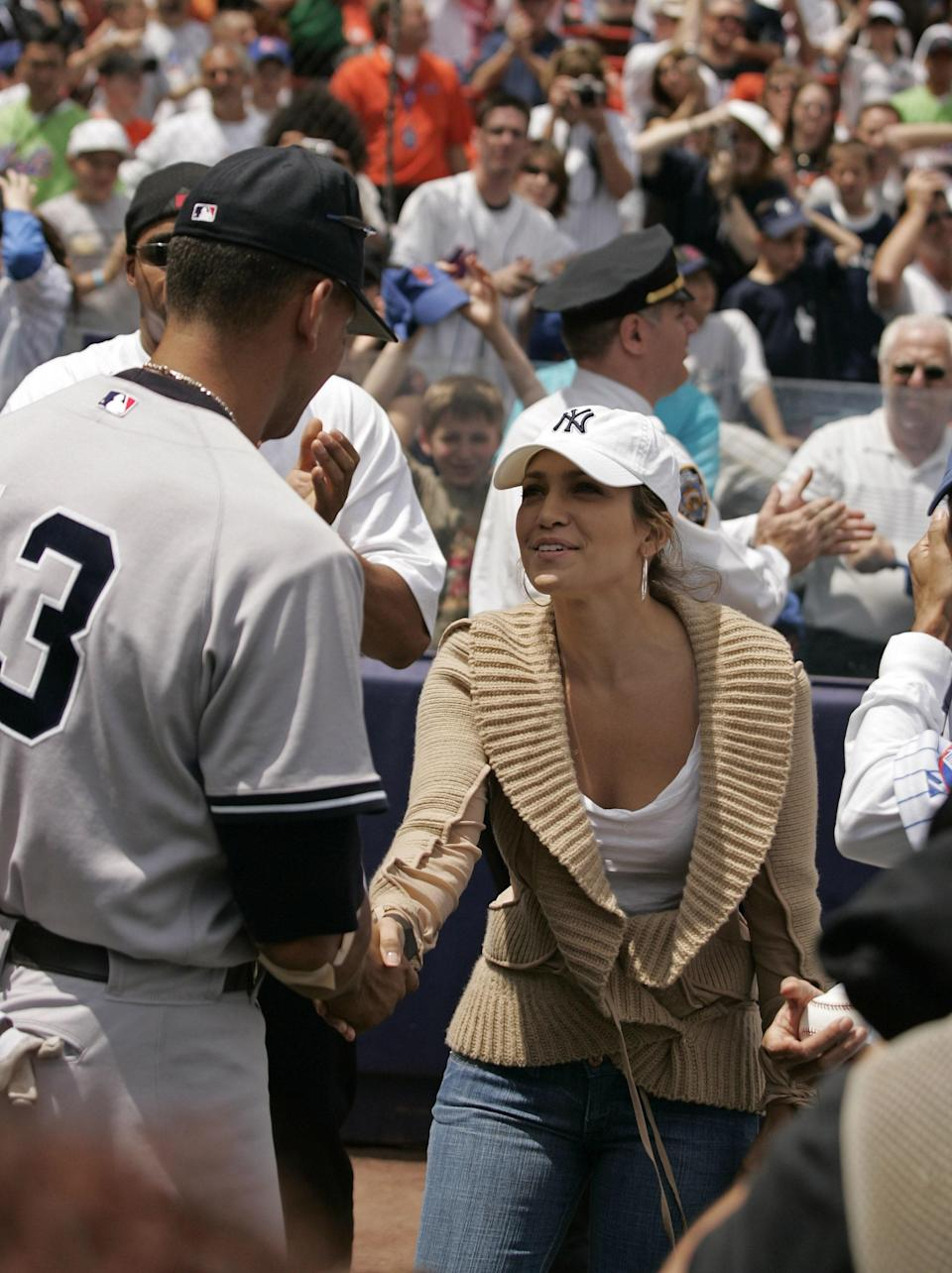 Actress Jennifer Lopez shakes hans with Alex Rodriguez before a subway series game between the New York Mets and the New York Yankees at Shea Stadium in Queens, New York on Saturday May 21, 2005. The Mets beat the Yankees 7-1. (Photo by Mike Ehrmann/WireImage)
