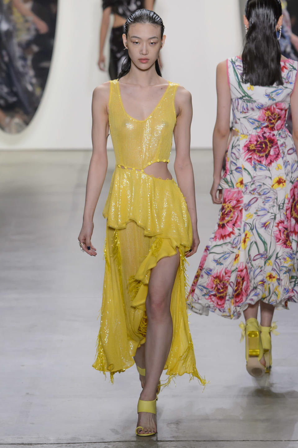<p><i>Model wears a yellow sparkling dress with cutouts from the SS18 Prabal Gurung collection. (Photo: ImaxTree) </i></p>