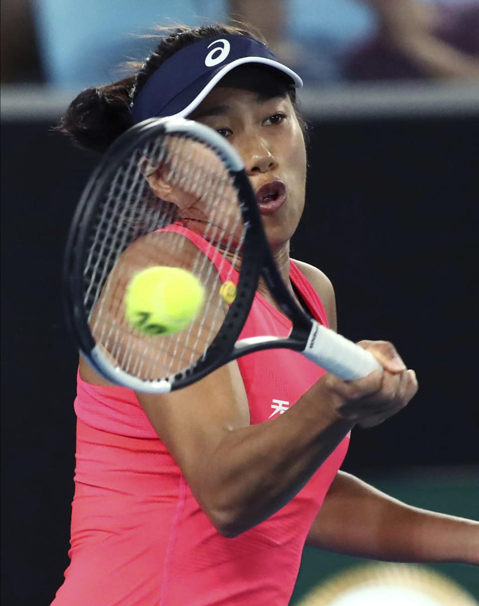 China's Zhang Shuai makes a forehand return to United States' Sloane Stephens during their first round singles match at the Australian Open tennis championship in Melbourne, Australia, Monday, Jan. 20, 2020. (AP Photo/Dita Alangkara)