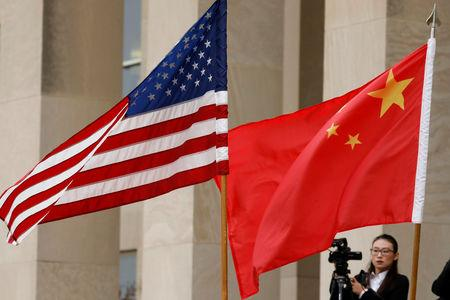 FILE PHOTO - U.S. and Chinese flags are seen before Defense Secretary James Mattis welcomes  Chinese Minister of National Defense Gen. Wei Fenghe to the Pentagon in Arlington, Virginia, U.S., November 9, 2018. REUTERS/Yuri Gripas