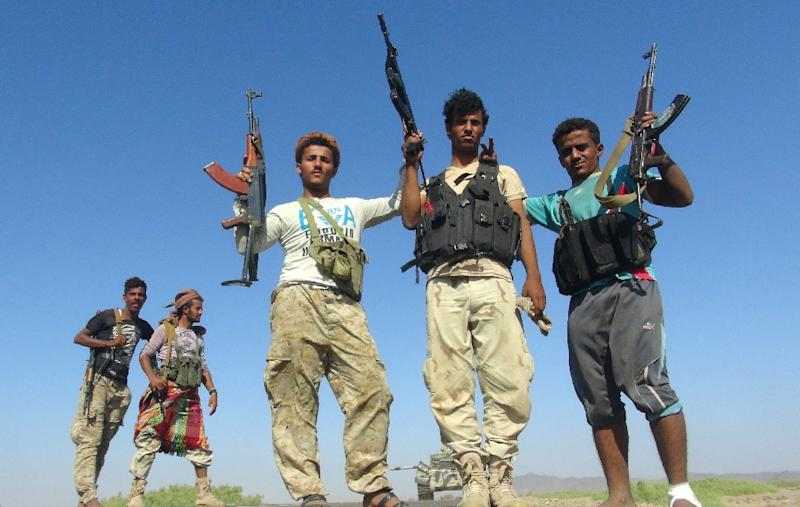 Armed Yemeni tribesmen from the Popular Resistance Committees, supporting forces loyal to Yemen's Saudi-backed President Abedrabbo Mansour Hadi, flash their guns in the Dabab district in Taez province on November 17, 2015