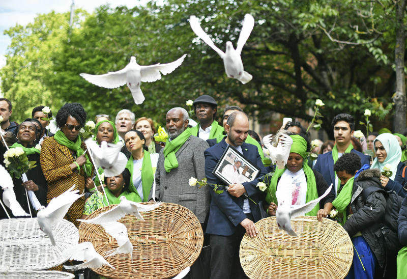 People gather as doves are released outside St Helens church, following a service to mark the two-year anniversary of the Grenfell Tower block fire, in London, Friday, June 14, 2019. Survivors, neighbors and politicians including London Mayor Sadiq Khan attended a church service of remembrance on Friday for the Grenfell Tower blaze, the deadliest fire on British soil since World War II. (Dominic Lipinski/PA via AP)