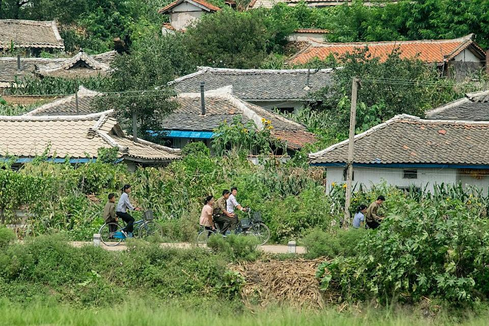 <p>Cycle paths were introduced in North Korea in 2015, but only in Pyongyang. Slowly, more and more people are able to afford bicycles, but this doesn't extend to the villages. (Getty) </p>