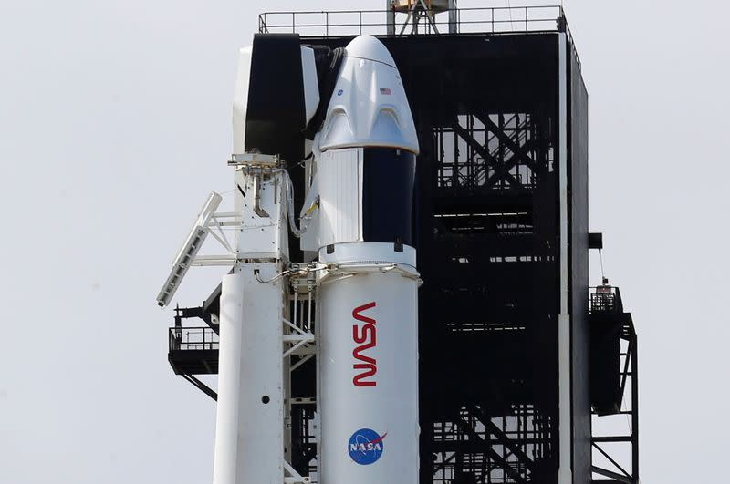 A SpaceX Falcon 9 rocket and Crew Dragon capsule is readied for launch in Cape Canaveral