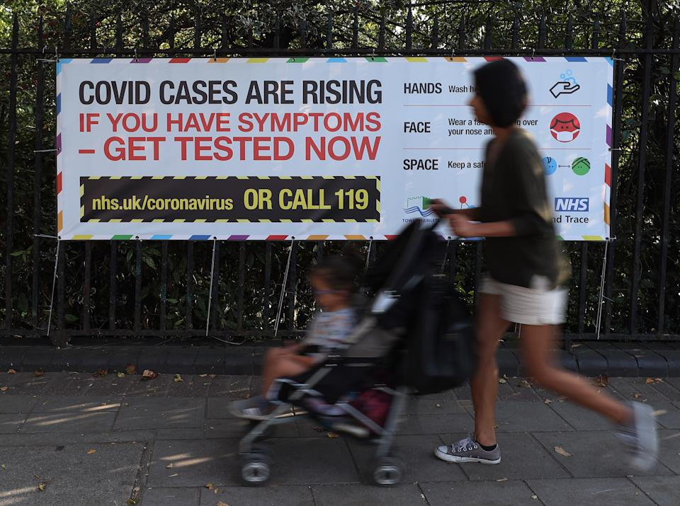 A public information sign warning of rising Covid-19 cases in London after Prime Minister Boris Johnson announced a range of new restrictions to combat the the coronavirus outbreak in England. (Photo by Yui Mok/PA Images via Getty Images)