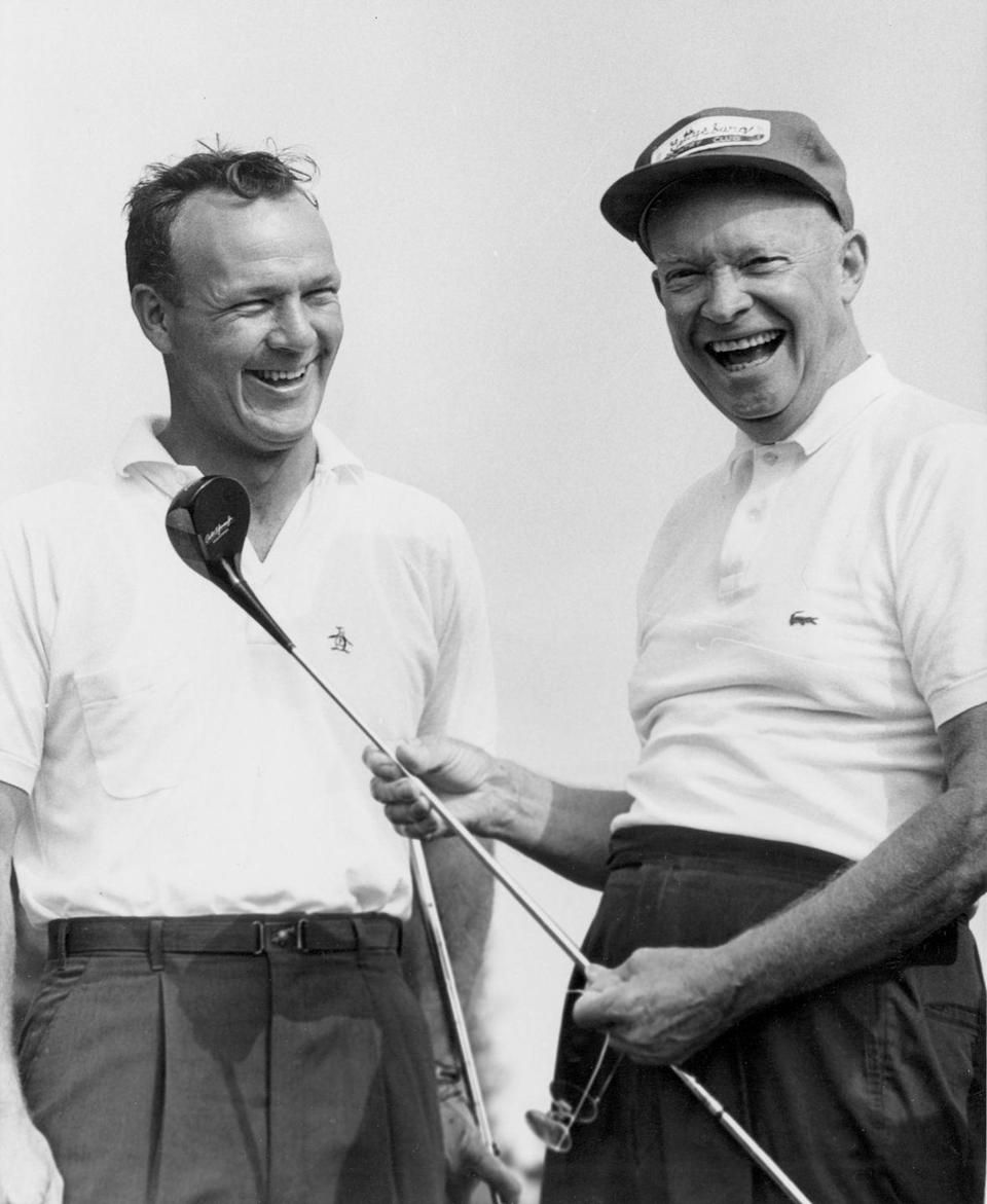 <p>Most presidents in modern history have enjoyed a good day of puttering around the golf course, and President Eisenhower was no exception. Here, he's pictured with golf pro Arnold Palmer circa 1960. </p>