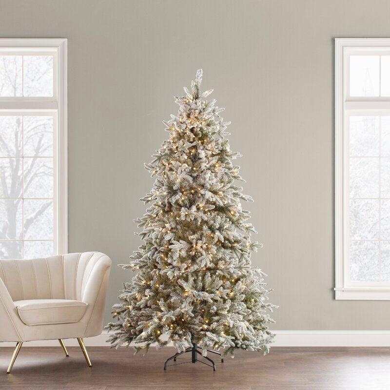 """<br><br><strong>The Holiday Aisle</strong> Spruce Artificial Christmas Tree with White Lights, $, available at <a href=""""https://go.skimresources.com/?id=30283X879131&url=https%3A%2F%2Ffave.co%2F2Tuph7M"""" rel=""""nofollow noopener"""" target=""""_blank"""" data-ylk=""""slk:Wayfair"""" class=""""link rapid-noclick-resp"""">Wayfair</a>"""